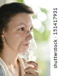 close up woman with an inhaler... | Shutterstock . vector #151417931