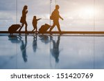 Silhouette of young family with ...