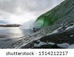 A Surfer On A Wave Crashign...