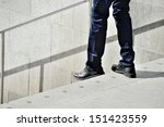 Man stepping down stairs - stock photo