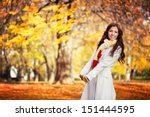 Young Woman In Beautiful Autum...