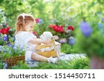 Stock photo beautiful little girl with red hair in a white retro pajamas bathes and washes a white young 1514450711