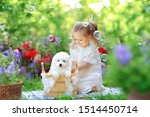Stock photo beautiful little girl with red hair in a white retro pajamas bathes and washes a white young 1514450714