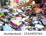 Small photo of Costa Mesa, California/United States - 08/25/2019: People rummage through a table full of a variety of makeup products