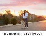 Stock photo young woman walking her adorable akita inu dog outdoors 1514498024