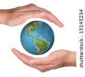 Earth globe between two hands - environmental protection concept - stock photo