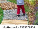 Child Walking Along Garden Path ...
