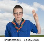 Постер, плакат: boy scout making an