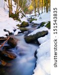 Stream With Soft Water And Snow