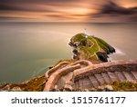 Lighthouse On Coastal Island...
