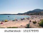 people enjoying the beach at... | Shutterstock . vector #151579595