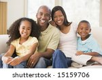 family sitting in living room... | Shutterstock . vector #15159706