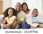 family sitting in living room... | Shutterstock . vector #15159706