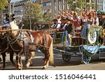 Small photo of MUNICH, GERMANY - SEPTEMBER 22, 2019 Grand entry of the Oktoberfest landlords and breweries, festive parade of magnificent decorated carriages and bands.Carriage with show people and vendors