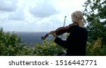 Blonde Girl Playing The Violin...