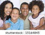 family in living room smiling | Shutterstock . vector #15164845
