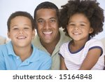 man and two young children... | Shutterstock . vector #15164848