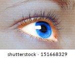 Woman blue eye looking on a digital virtual screen close-up  - stock photo