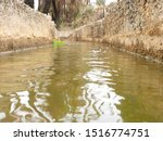 """traditional Waterways for watering the oases of """"Tighmert - Guelmim"""" in Morocco."""