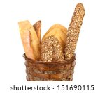 Various types of bread in a basket. - stock photo