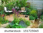 relaxation area in a garden | Shutterstock . vector #151725065