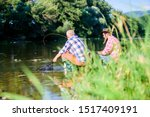 Poaching crime and fishing license. Black market caviar. Poachers fishing. Illegal hunting caviar. Extracts eggs from sturgeon caught river. Trap for fish. Men sit at riverside with fishing equipment. - stock photo