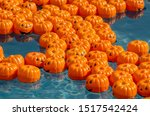 tiny pumpkins float in a child... | Shutterstock . vector #1517542424