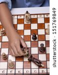 The queen defeating the king in a concept image of a chess game. - stock photo