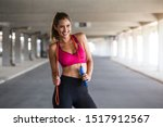 sporty woman warming up with...   Shutterstock . vector #1517912567