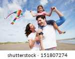Family Having Fun Flying Kite...