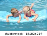 two children swimming on a... | Shutterstock . vector #151826219