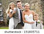 Bride And Groom With Bridesmai...