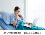 Small photo of One asian young female patient expressed confidence embolden on bed and laptop computer in the room hospital background,concept of working business in a sick time