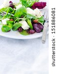 Healthy mix green salad with cranberry, almonds and feta for a gourmet light meal lunch dinner appetizer    - stock photo