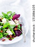Delicious gourmet salad with cranberry, almonds and feta for a gourmet light meal lunch dinner appetiser    - stock photo