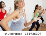 group of women exercising in... | Shutterstock . vector #151936307
