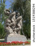 """Small photo of Volgograd, Russia - August 22,2019; Mamayev Kurgan. Monument-ensemble """"To the Heroes of the Battle of Stalingrad."""" Two fighters dump the swastika and the fascist hydra into the Volga """""""