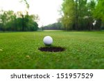 golf ball on lip of cup. | Shutterstock . vector #151957529