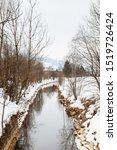 Bruck winter landscape.  A stream flows through the village of Bruck an der Grossglocknerstrasse in mid winter in the state of Salzburg, Austria.
