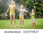 little boy is pouring a water... | Shutterstock . vector #151974527