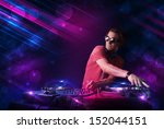 attractive young dj playing on... | Shutterstock . vector #152044151
