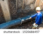 Small photo of Construction site of pipeline.Holiday test or a Continuity test is one of the non destructive test method applied on protective coatings to detect unacceptable discontinuities such as pinholes & voids