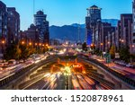 Small photo of Tehran,Iran,Famous night view of Tehran,Flow of traffic round Tohid Tunnel with Milad Tower and Alborz Mountains in Background, Tohid Tunnel one of longest urban tunnel in Middle East