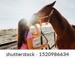 Happy Girl Kissing Horse In...