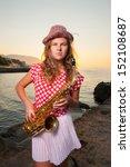Girl Playing On Saxophone...