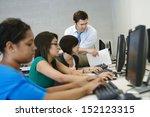 teacher helping student in... | Shutterstock . vector #152123315