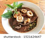 Small photo of Thai boat noodles is Thailand's most famous noodles soup,Thai Boat noodles soup or Guay tiew reua ,Rice noodles thicken soup with stewed pork and pork ball ,Braised pork and liver pork ,Thai localfood
