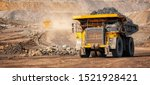 Open pit mine industry, big yellow mining truck for coal anthracite. - stock photo