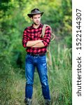Small photo of Cowboys are gentlemen. wild west rodeo. man in hat outdoor. man checkered shirt on ranch. Vintage style man. Wild West retro cowboy. cowboy with lasso rope. Western. western cowboy portrait.