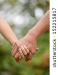 hands held together on a... | Shutterstock . vector #152215817